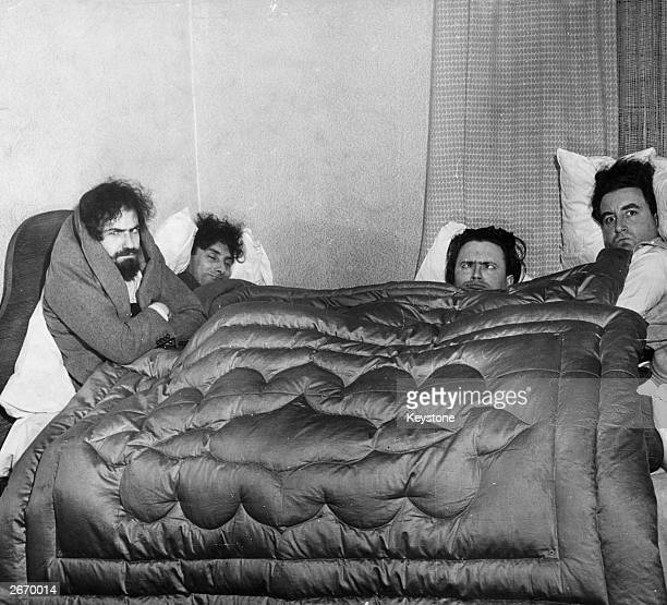 Comedians Michael Bentine Spike Milligan Harry Secombe and Peter Sellers aka the Goons sharing a double bed in a sketch inspired by the experiences...