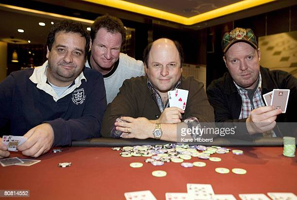 Comedians Mick Molloy Russell Gilbert Jason Alexander and Peter Helliar pose at a card table after a press conference to announce the start of...