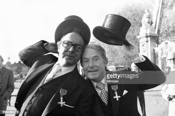 Comedians Morecambe and Wise seen here showing off their medals outside Buckingham Palace after being invested by HM The Queen with the OBE 23rd...