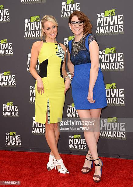 Comedians Nikki Glaser and Sara Schaefer arrive at the 2013 MTV Movie Awards at Sony Pictures Studios on April 14 2013 in Culver City California
