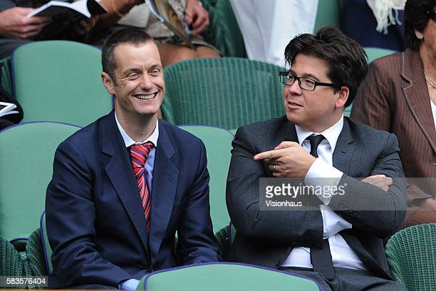 Comedians Paul Tonkinson and Michael McIntyre share a joke during the Ladies Singles Final match between Serena Williams and Agnieszka Radwanska on...
