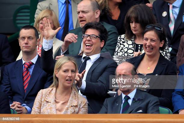 Comedian's Paul Tonkinson, Michael McIntyre and Miranda Hart in the royal box during day twelve of the 2012 Wimbledon Championships at the All...