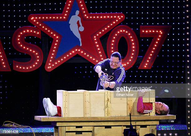 Comedians Penn Jillette and Teller perform a magic trick with NBA's Tony Parker at NBA AllStar Saturday Night at Thomas Mack Center February 17 2007...