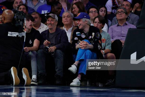 Comedians Pete Davidson and Jon Stewart watch during the second half between the Boston Celtics and the New York Knicks at Madison Square Garden on...