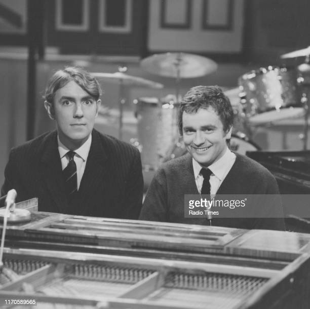 Comedians Peter Cook and Dudley Moore sitting at a piano on the set of the BBC television series 'Not Only But Also' circa 1965