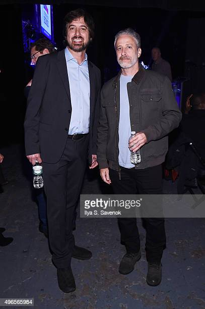 Comedians Ray Romano and Jon Stewart pose backstage at the New York Comedy Festival and the Bob Woodruff Foundation's 9th Annual Stand Up For Heroes...