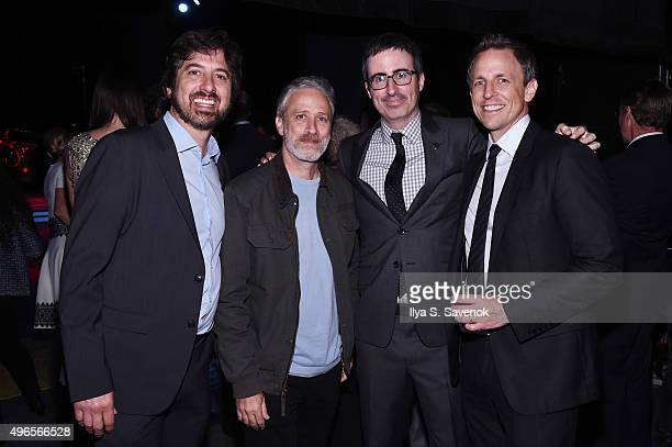 Comedians Ray Romano Jon Stewart John Oliver and Seth Meyers pose backstage at the New York Comedy Festival and the Bob Woodruff Foundation's 9th...