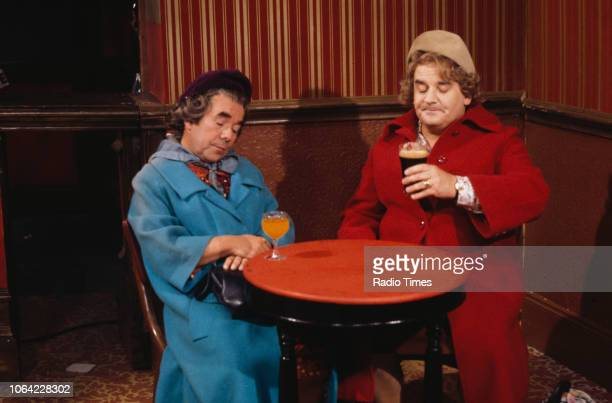 Comedians Ronnie Corbett and Ronnie Barker dressed as women in a pub sketch from the television series 'The Two Ronnies', 1978.