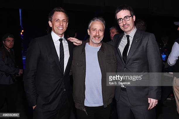 Comedians Seth Meyers Jon Stewart and John Oliver pose backstage at the New York Comedy Festival and the Bob Woodruff Foundation's 9th Annual Stand...