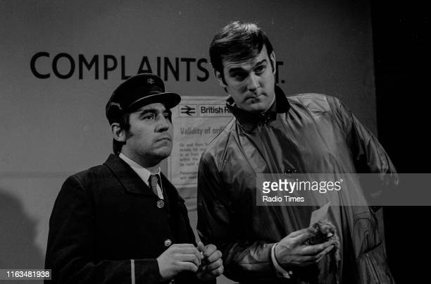 Comedians Terry Jones and John Cleese in the 'Dead Parrot' sketch from series 1 of the BBC television show 'Monty Python's Flying Circus' 1969