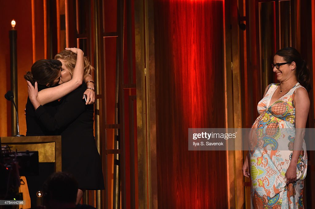 Comedians Tina Fey and Amy Schumer kiss onstage at The 74th Annual Peabody Awards Ceremony at Cipriani Wall Street on May 31, 2015 in New York City.
