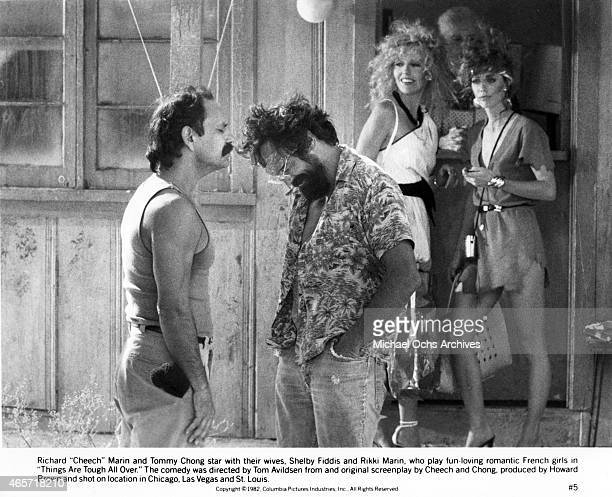 Comedians Tommy Chong and Cheech Marin in a scene from their movie 'Things Are Tough All Over' with their wives Shelby Fiddis and Rikki Marin which...