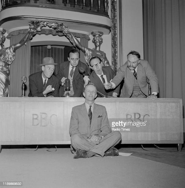 Comedians Tommy Trinder, Derek Roy, Arthur Askey and Jimmy Edwards joking around with BBC continuity announcer McDonald Hobley , during a recording...