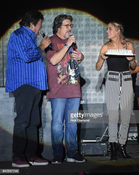 Comedians Williams and Ree L/R Terry Ree Bruce Williams with Birthday Girl Singer/Songwriter Lucy Voll on stage at Country Thunder Music Festival...