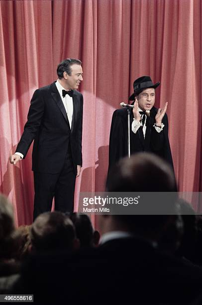 Comedians writers and directors Carl Reiner and Mel Brooks perform their routine 'The 2000 Year Old Man' circa 1967 in Los Angeles California