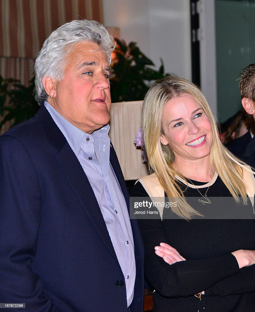 Comedians/TV personalities Jay Leno (L) and Chelsea Handler at 'Roast and Toast with Ross Mathews' hosted by Target to celebrate the launch of Mathews' book 'Man Up!' at Sunset Tower on May 1, 2013 in West Hollywood, California.