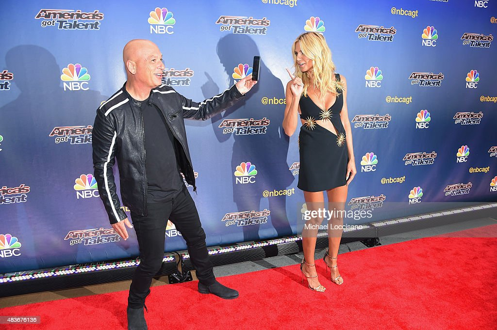 Comedian/TV personality Howie Mandel takes a picture of model/TV personality Heidi Klum before the 'America's Got Talent' season 10 taping at Radio City Music Hall on August 11, 2015 in New York City.