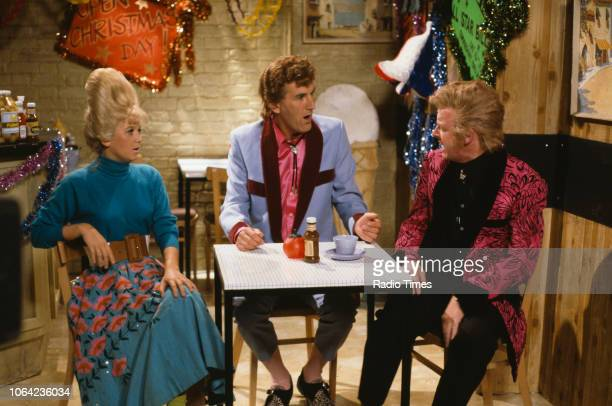 Comedic actors Lisa Maxwell Russ Abbot and Les Dennis in a sketch from the Christmas special of BBC Television series 'The Russ Abbot Show' August...