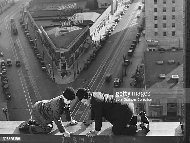 Comedic actors Stan Laurel and Oliver Hardy in a precarious scene in the 1929 comedy Liberty