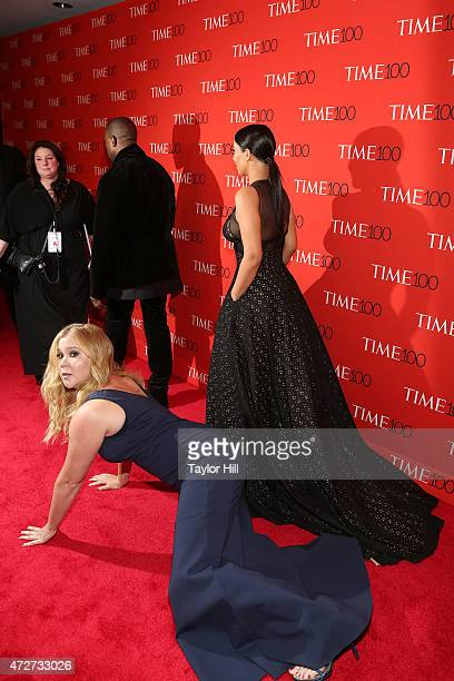 Comedienne Amy Schumer prostrates herself in front of Kim Kardashian and Kanye West at the 2015 Time 100 Gala at Frederick P. Rose Hall, Jazz at...