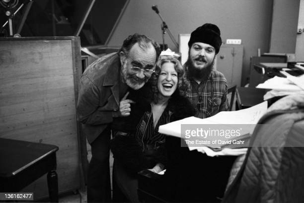 Comedienne and singer Bette Midler with producer Jerry wexler and musician Dr John pose for a portrait in the studios of Atlantic Records in October...