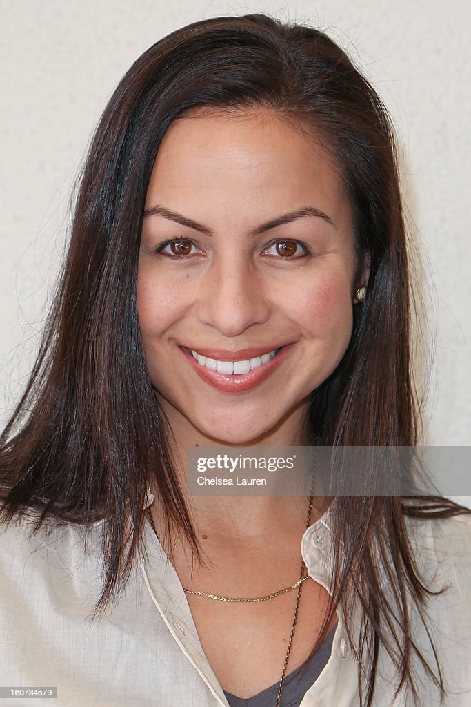 Comedienne Anjelah Johnson attends anti-human trafficking family charity luncheon in support of Unlikely Heroes at Veggie Grill on February 4, 2013 in Los Angeles, California.