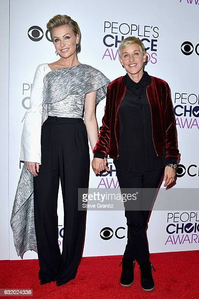 Comedienne Ellen DeGeneres winner of a recordsetting 20 career People's Choice Awards poses with actress Portia de Rossi in the press room during the...