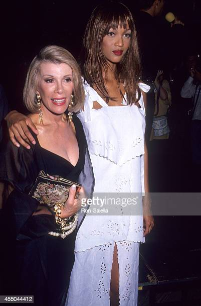 Comedienne Joan Rivers and model Tyra Banks attend the Second Annual 'Boathouse Rock' Dance Party to Benefit amfAR on June 28 1993 at the Central...