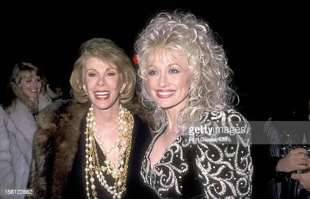 Comedienne Joan Rivers and Musician Dolly Parton attend Sandy Gallin's Holiday Party on December 18 1988 at the Home of Sandy Gallin in Beverly Hills...