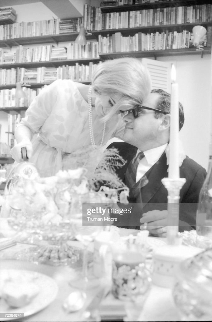 Comedienne Joan Rivers kissing her husband, producer Edgar Rosenberg, while serving him tea. [Scanned from contact sheet.].