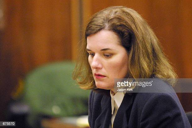 Comedienne Paula Poundstone takes a moment at the Santa Monica Superior Court December 5, 2001 in Santa Monica, CA. Judge Bernard J. Kamins ruled...