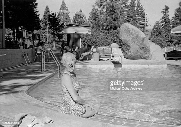 Comedienne Phyllis Diller in her pool at home in August 1959 in Los Angeles California