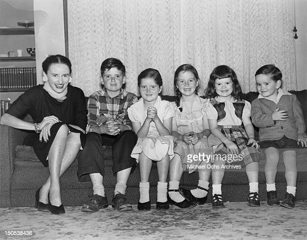 Comedienne Phyllis Diller poses for a portrait with her children circa 1953 in Oakland California