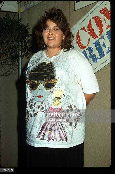 Comedienne Roseanne Barr stands in front of a sign promoting HBO's 'Comic Relief' November 14 1987 in Los Angeles CA For the second consecutive year...
