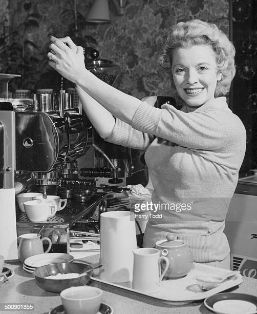 Comedienne Sally Barnes operating the pump of a coffee machine at her cafe 'Sally's Inn' St Albans November 21st 1958