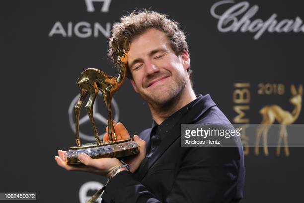 'Comedy' award winner Luke Mockridge poses with award during the 70th Bambi Awards winners board at Stage Theater on November 16 2018 in Berlin...