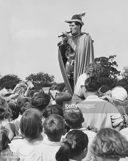 Comedy conjuror Tommy Cooper performing as the pied piper at a fundraising event for the Barnardo's children's charity at Harlow New Town Essex 25th...