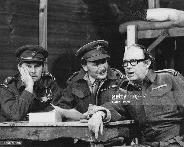 Comedy double act Eric Morecambe and Ernie Wise performing an army sketch with actor John Mills in an episode of 'The Morecambe Wise Show' June 1971