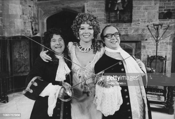 Comedy double act Eric Morecambe and Ernie Wise posing with actress Diana Rigg as they film scenes for 'The Morecambe Wise Christmas Show' November...