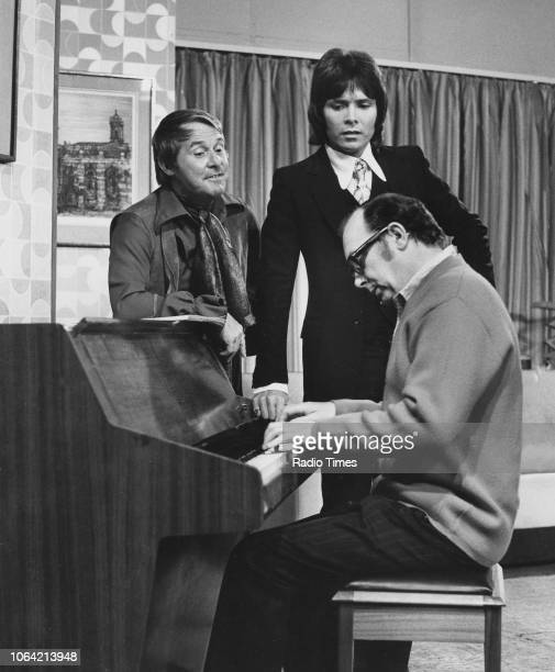 Comedy double act Eric Morecambe and Ernie Wise singing with pop star Cliff Richard during an episode of 'The Morecambe and Wise Show' October 10th...