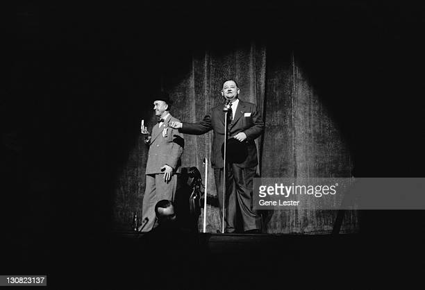 Comedy double act Stan Laurel and Oliver Hardy performing on stage in a Hollywood Victory Caravan show USA 16th May 1942 The Hollywood Victory...