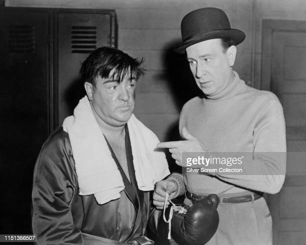 Comedy duo Lou Costello and Bud Abbott pose as a boxer and his manager in the film 'Abbott And Costello Meet The Invisible Man' 1951