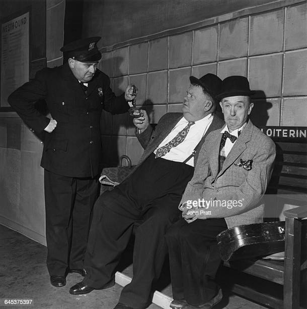 Comedy duo Stan Laurel and Oliver Hardy are arrested for loitering at a railway station in the sketch 'A Spot Of Trouble' performed on stage during...
