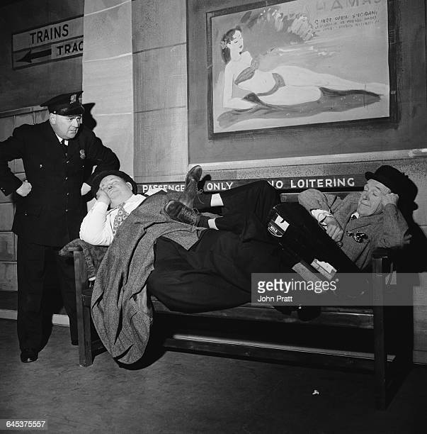 Comedy duo Stan Laurel and Oliver Hardy are found napping in front of a 'No Loitering' sign at a railway station in the sketch 'A Spot Of Trouble'...
