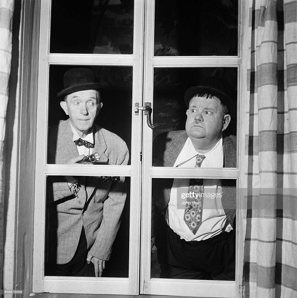 Comedy duo Stan Laurel (1890 - 1965) and Oliver Hardy (1892 - 1957) perform the sketch 'A Spot Of Trouble' on stage during their tour of the UK, 25th February 1952. The plot was a reworking of their 1930 comedy short 'Night Owls'.