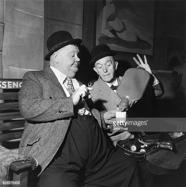 Comedy duo Stan Laurel and Oliver Hardy share an impromptu cup of coffee at a railway station in the sketch 'A Spot Of Trouble' performed on stage...