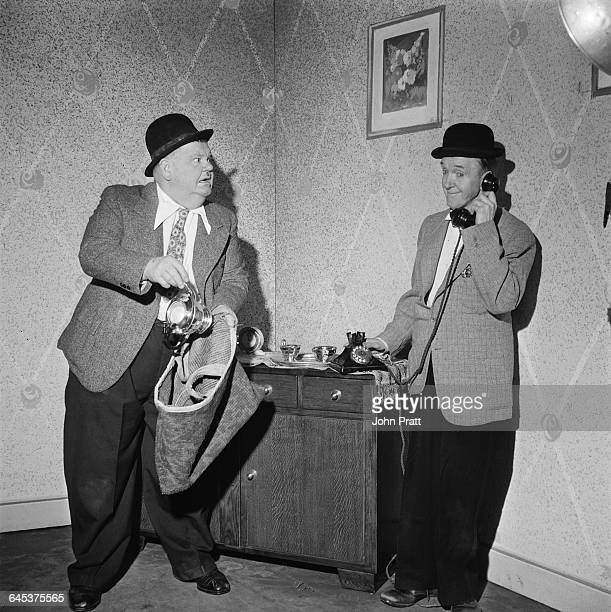 Comedy duo Stan Laurel and Oliver Hardy stage a burglary in the sketch 'A Spot Of Trouble' performed on stage during their tour of the UK 25th...