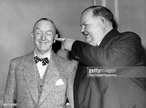 Comedy duo Stan Laurel on left and Oliver Hardy pictured together at a press reception at their hotel in London following their arrival from the...