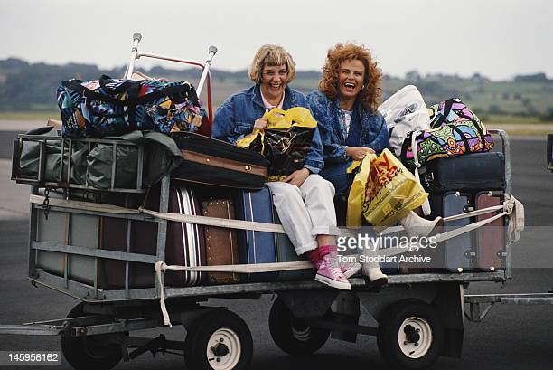 Comedy duo Victoria Wood and Julie Walters on an airport baggage trolley 1990