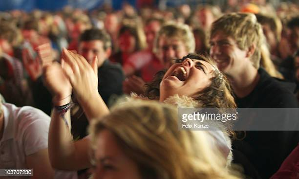 A comedy fan is seen laughing while watching a performance by standup comedian Russell Kane on day three of the Reading Festival on August 29 2010 in...